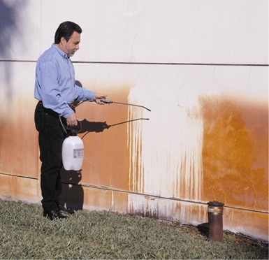 Image of bad rust and iron stains from irrigation on the side of a house.